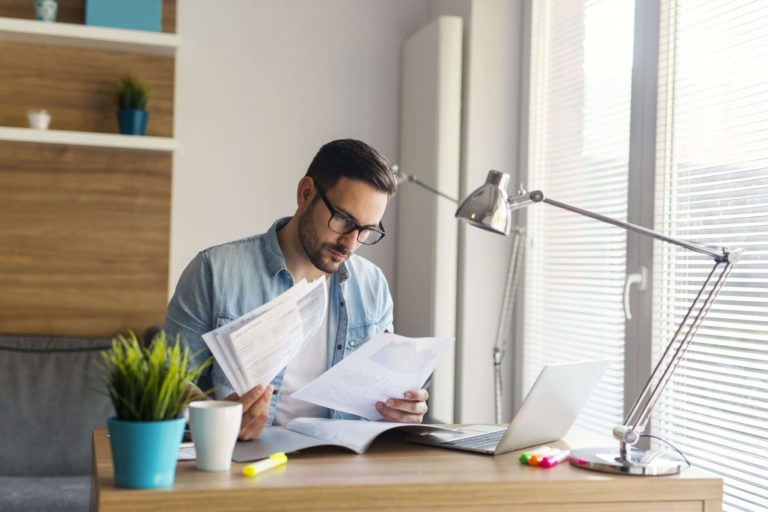 Man reading long-term definition of disability