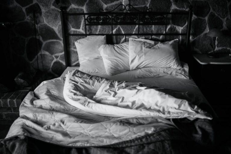 unmade bed; sleep disturbances