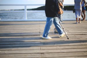 disabled person walking with cane