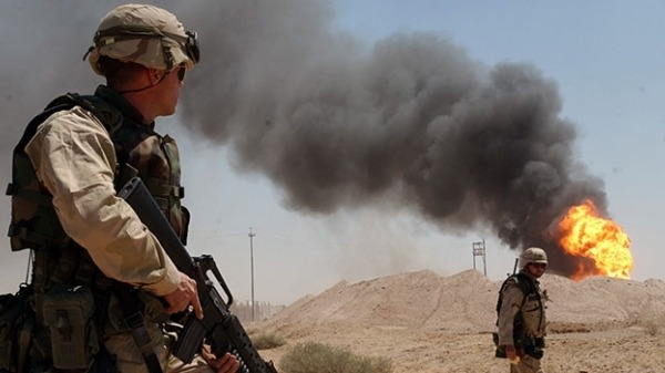 soldiers in front of DoD sponsored toxic military burn pit