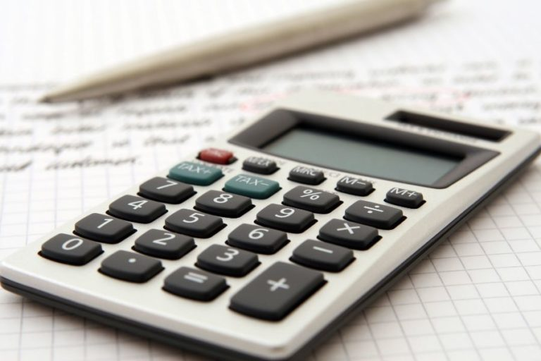 calculator with pencil on paper to symbolize 2020 va disability pay chart calculations
