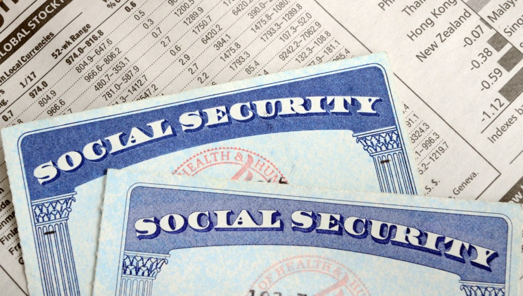 two social security cards on top of financial statement