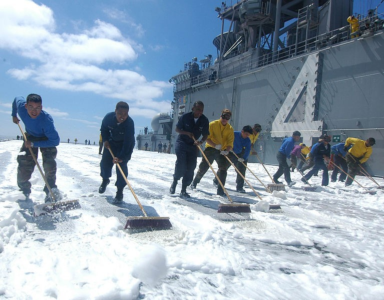 sailors mopping AFFF firefighting foam on Navy ship